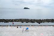 people relaxing Tokyo Bay with Sarushima island in Yokosuka Japan