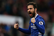 Cesc Fabregas of Chelsea celebrates their win at the end of the match. Premier league match, Stoke City v Chelsea at the Bet365 Stadium in Stoke on Trent, Staffs on Saturday 18th March 2017.<br /> pic by Andrew Orchard, Andrew Orchard sports photography.