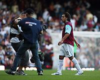 Photo: Chris Ratcliffe.<br /> West Ham United v Aston Villa. The Barclays Premiership. 10/09/2006.<br /> Carlos Tevez of West Ham leaves the field as the camera follows him.