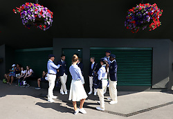 Line judges outside a court on day two of the Wimbledon Championships at the All England Lawn Tennis and Croquet Club, Wimbledon