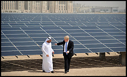The London Mayor Boris Johnson looks at the Solar panels at Masdar City, Adu Dhabi, with Naser Ali Al Marzooqi, Head of Facilities Management. The Mayor is on a 2 day tour of the UAE, Monday April 15, 2013. Photo By Andrew Parsons / i-Images