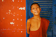 Portrait of a young buddhist monk  in a monastery around Phnom Penh, Cambodia, Southeast Asia