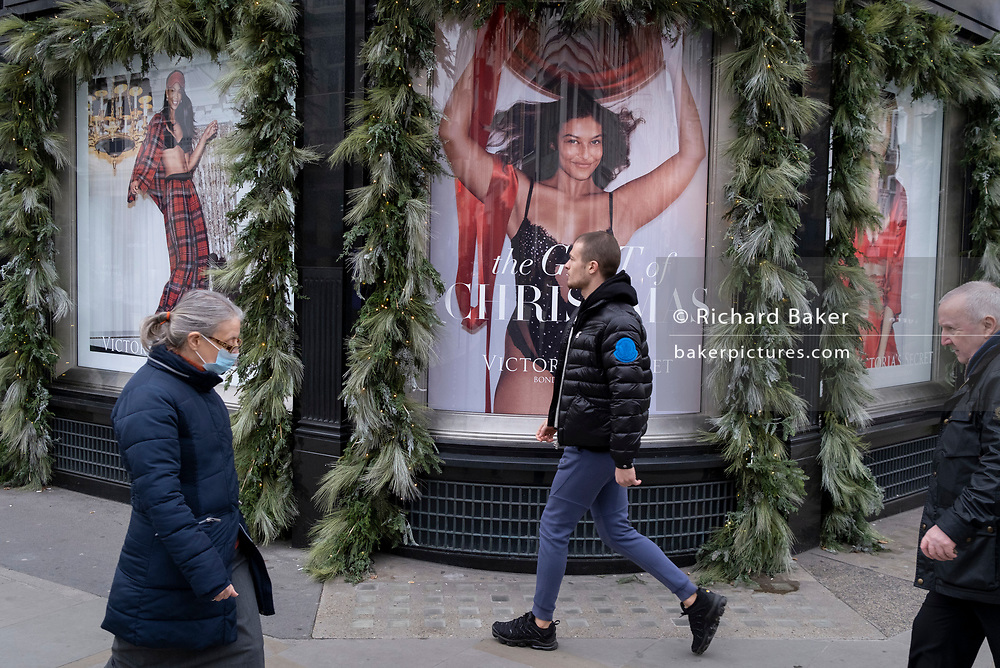 As England finishes its second Coronavirus pandemic lockdown, and London enters a Tier 2 restriction, Londoners walk past the Victoria's Secret Bond Street shop in the West End, to start their Christmas high street shopping, on 2nd December 2020, in London, England.