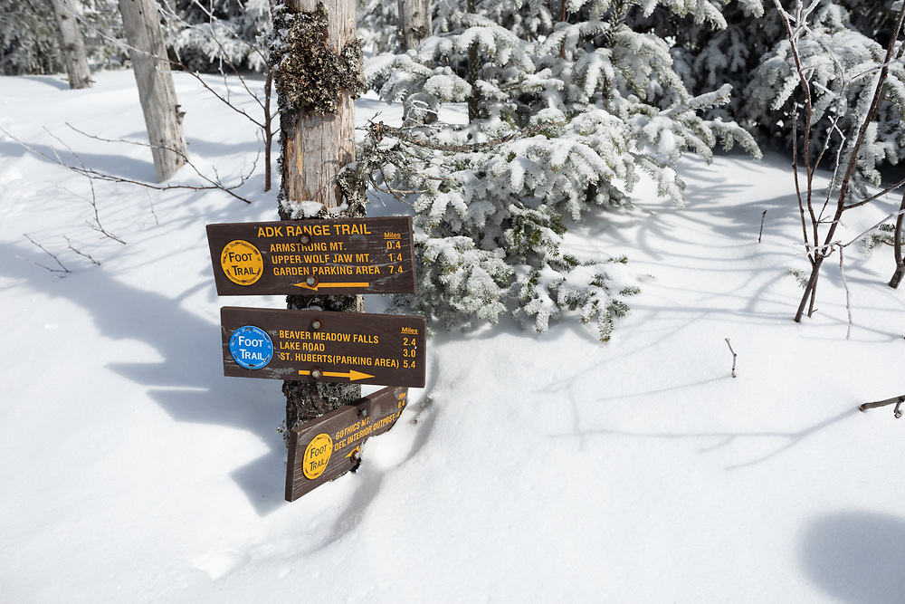 Trail signs buried in the snow
