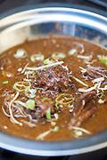 A dish of nihari at the Ghaffar nihari wallah, Old Delhi, India