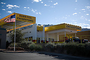.An American flag waves on the property adjacent to the new Burritos Crisostomo in El Paso Texas on Sunday morning, Oct. 11, 2009..