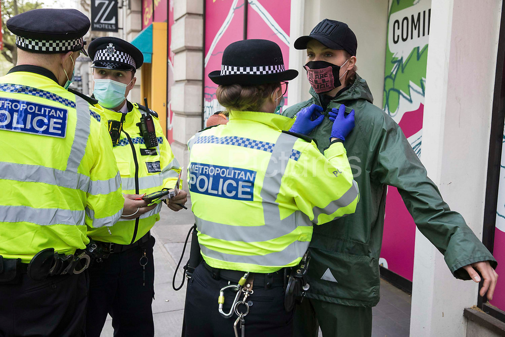 An activist from Palestine Action is searched by a Metropolitan Police officer during a protest outside the UK headquarters of Elbit Systems, an Israel-based company developing technologies used for military applications including drones, precision guidance, surveillance and intruder-detection systems, on 11th May 2021 in London, United Kingdom. The activists were protesting against the companys presence in the UK and in solidarity with the Palestinian people at a time of a significant rise in tension in Israel and the Occupied Territories following attempts at forced evictions of Palestinian families in the Sheikh Jarrah neighbourhood of East Jerusalem, the deployment of Israeli forces at the Al-Aqsa mosque and the killing of children in Gaza.