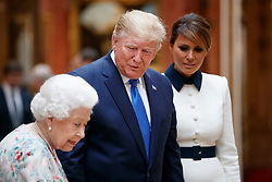 First Lady Melania Trump (right) Queen Elizabeth II with US President Donald Trump view a special exhibition in the Picture Gallery of items from the Royal Collection of historical significance to the US, following a private lunch at Buckingham Palace in London, on day one of his three day state visit to the UK.