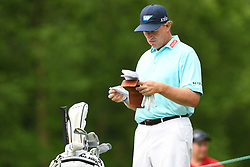 May 3, 2019 - Charlotte, NC, U.S. - CHARLOTTE, NC - MAY 03:  Ernie Els goes over the notes for the 13th hole before teeing off in round two of the Wells Fargo Championship on May 03, 2019 at Quail Hollow Club in Charlotte,NC. (Photo by Dannie Walls/Icon Sportswire) (Credit Image: © Dannie Walls/Icon SMI via ZUMA Press)