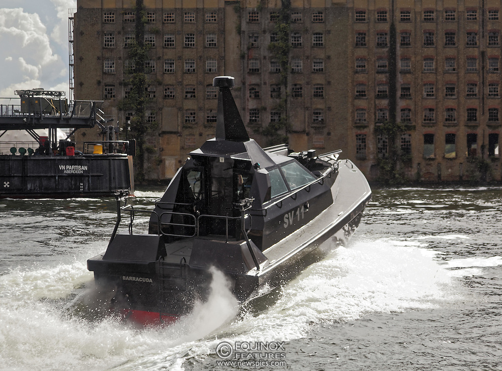 London, United Kingdom - 18 September 2015<br /> Safehaven Marine demonstrate their SV11 Barracuda stealth boat with front mounted retractable gun and radar avoidance technology at Operation MARICAP waterborne demonstration at the defence and security exhibition DSEI at ExCeL, Woolwich, London, England, UK.<br /> (photo by: EQUINOXFEATURES.COM)<br /> <br /> Picture Data:<br /> Photographer: Equinox Features<br /> Copyright: ©2015 Equinox Licensing Ltd. +448700 780000<br /> Contact: Equinox Features<br /> Date Taken: 20150918<br /> Time Taken: 14345090<br /> www.newspics.com