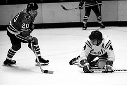 Chicago Blackhawks Cliff Koroll and the Seals Bob Stewart. (1975 photo/Ron Riesterer)