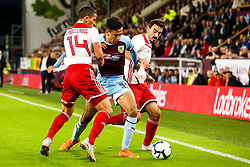 Dwight McNeil of Burnley takes on Omar Elabdellaoui and Lazaros Christodoulopoulos of Olympiakos - Mandatory by-line: Robbie Stephenson/JMP - 30/08/2018 - FOOTBALL - Turf Moor - Burnley, England - Burnley v Olympiakos - UEFA Europa League Play-offs second leg