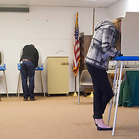 110612       Brian Leddy<br /> Emily Bruegger votes at the Octavia Fellin Public Library Tuesday. This election could be one of the most closely contested in years.