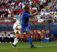 24/08/04 - ATHENS - GREECE -  - OLYMPIC FOOTBALL - SEMIFINALS - MENS  -  <br />ITALY VS. ARGENTINA ().<br />At Karaiskaki Stadium in Faliro / Athens<br />Argentine N*10 CARLSO TEVEZ GOAL and Italy N*4 FERRARI MATTEO<br />© Gabriel Piko / Argenpress.com / Piko-Press