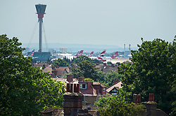 © London News pictures...  01/07/2015. Harmondsworth, UK. View over the village of Harmondsworth in West London, showing planes taking off form Heathrow airport inn the background. Harmondsworth is due to be demolished to make way for a third runway at Heathrow Airport if plans go ahead. The airports commission today (Weds) gave it's backing for the £18.6bn plan for a third runway at Heathrow. Photo credit: Ben Cawthra/LNP