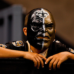 August 21, 2010; New Orleans, LA, USA; A New Orleans Saints fan watches during the second half of a 38-20 win by the New Orleans Saints over the Houston Texans during a preseason game at the Louisiana Superdome. Mandatory Credit: Derick E. Hingle