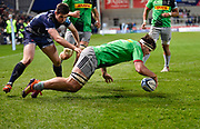 Harlequins flanker Jack Clifford touches down for a try despite the efforts of Sale Sharks full back Luke James during a Gallagher Premiership match at the AJ Bell Stadium, Eccles, Greater Manchester, United Kingdom, Friday, April 5, 2019. (Steve Flynn/Image of Sport)