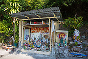 A Buddhist roadside shrine on Nam Fung Road, Hong Kong.