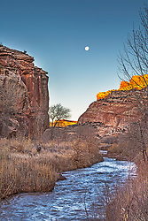 Full moon over the Fremont River as it flows though Capital Reef National Park.