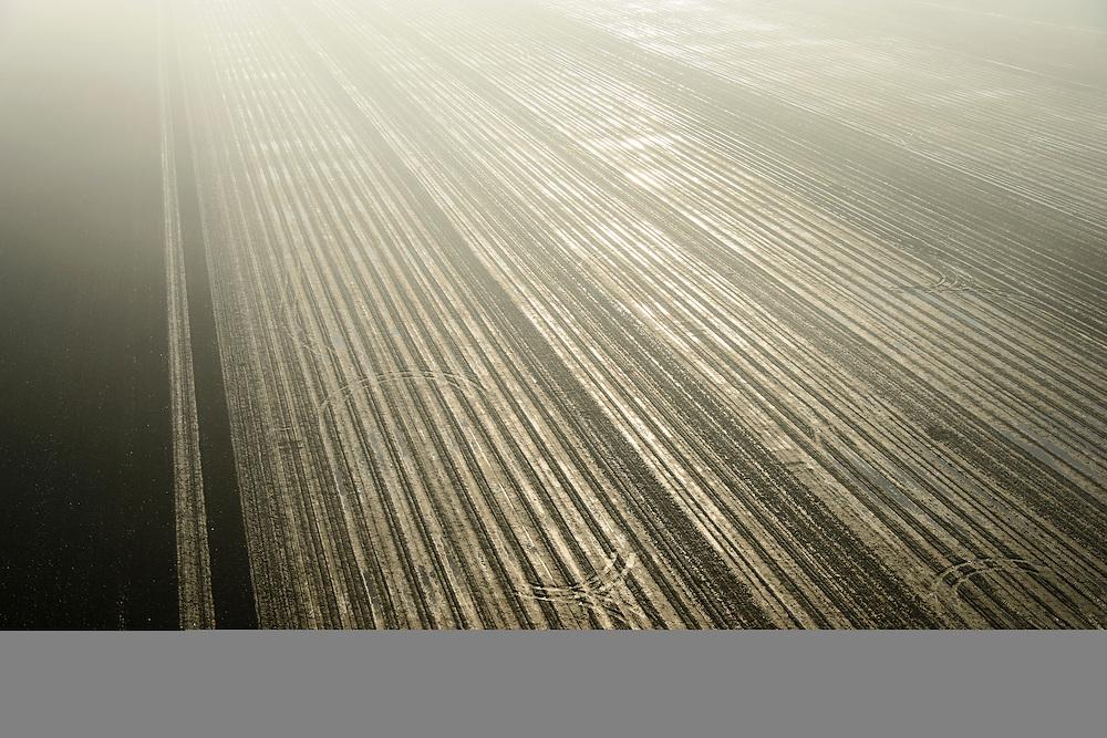 Nederland, Flevoland, Lelystad, 11-12-2013; Eendenweg, winterse akkers in de mist, omgeving Vliegveld Lelystad.<br /> Farms in the fog, environment of Lelystad Airport.<br /> luchtfoto (toeslag op standaard tarieven);<br /> aerial photo (additional fee required);<br /> copyright foto/photo Siebe Swart.