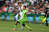 Jack Cork of Swansea city passes past Jesus Navas of Manchester city.  Barclays Premier league match, Swansea city v Manchester city at the Liberty Stadium in Swansea, South Wales on Sunday 15th May 2016.<br /> pic by Andrew Orchard, Andrew Orchard sports photography.