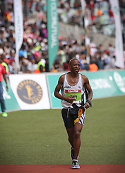 10062018 (Durban) A 9th position Gift Kelehe, RSA (5:46:50) run towards the finnish line during the 2018 Comrades marathon in Durban.<br /> Picture: Motshwari Mofokeng/ANA