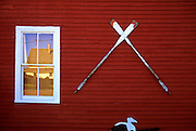Image of a wall with oars, town of Bernard on Mount Desert Island, Maine, American Northeast by Andrea Wells