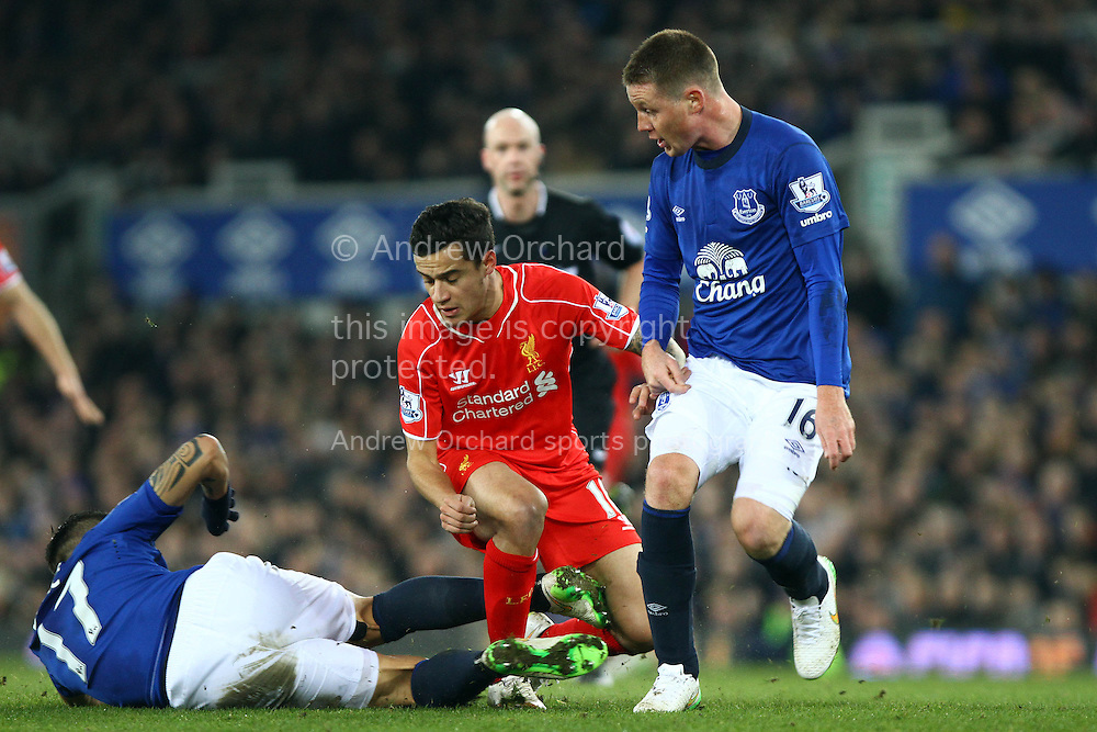 Philippe Coutinho of Liverpool is tackled by Muhamed Besic of Everton. Barclays Premier league match, Everton v Liverpool at Goodison Park in Liverpool, Merseyside on Saturday 7th February 2015<br /> pic by Chris Stading, Andrew Orchard sports photography.