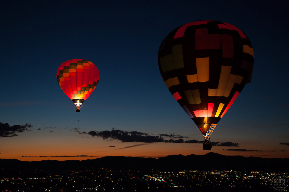 """""""Dawn Patrol 13"""" - Photograph of a glowing hot air balloon flying for the Dawn Patrol at the 2012 Great Reno Balloon Race. Photographed from a hot air balloon."""