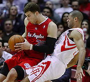 Jan 26, 2011; Houston, TX, USA; Houston Rockets small forward Shane Battier (31) draws a charge against Los Angeles Clippers power forward Blake Griffin (32) during the fourth quarter at the Toyota Center. The Rockets won 96-83. Mandatory Credit: Thomas Campbell-US Presswire