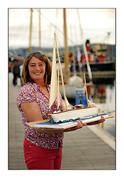 Day five of the Fife Regatta, lay day in Portavadie<br /> <br /> Fiona Houston with the birthday cake <br /> <br /> * The William Fife designed Yachts return to the birthplace of these historic yachts, the Scotland's pre-eminent yacht designer and builder for the 4th Fife Regatta on the Clyde 28th June–5th July 2013<br /> <br /> More information is available on the website: www.fiferegatta.com