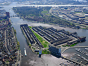 Nederland, Noord-Holland, Zaanstad;  03-23-2020; Het Eiland ook wel Zaaneiland. Gelegen in de monding van rivier de Zaan, tussen Voorzaan en de Oude Haven. Vroeger in gebruik bij de houtindustrie, o.a. houtwerven. Nieuwe woonwijk op eiland, waterstad. In de achtergrond Hembrugterrein.<br /> New residential area on former industrial area on island on the river Zaan in Zaandam.<br /> <br /> luchtfoto (toeslag op standard tarieven);<br /> aerial photo (additional fee required)<br /> copyright © 2020 foto/photo Siebe Swart