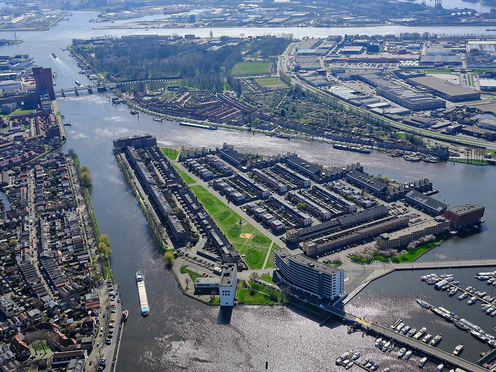 Nederland, Noord-Holland, Zaanstad;  03-23-2020; Het Eiland ook wel Zaaneiland. Gelegen in de monding van rivier de Zaan, tussen Voorzaan en de Oude Haven. Vroeger in gebruik bij de houtindustrie, o.a. houtwerven. Nieuwe woonwijk op eiland, waterstad. In de achtergrond Hembrugterrein.<br /> New residential area on former industrial area on island on the river Zaan in Zaandam.<br /> <br /> luchtfoto (toeslag op standard tarieven);<br /> aerial photo (additional fee required)<br /> copyright © 2020 foto/photo Siebe Swart