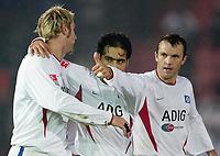 Fotball<br /> Tyskland 2003/2004<br /> Norway Only<br /> Foto: Digitalsport<br /> <br /> Jubel nach 1:3 v.l. Sergej Barbarez - Mehdi Mahdavikia - Romeo HSV<br /> DFB Pokal SpVgg Unterhaching - Hamburger SV 2:4