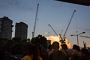 Crowds of people in front of the Glorietta Complex under construction in Makati, Metro Manila, Philippines. The two buildings are part of the Glorietta Mall on Palm Drive.  (photo by Andrew Aitchison / In pictures via Getty Images)