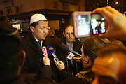 """Hassan Chalghoumi, Imam talks to press at Porte Vincennes<br /><br />French and Jews come together to make a vigil outside a Kosher supermarket in Porte Vincennes, Paris, France. Yesterday this Kosher supermarket was the scene of a hostage taking and followed by an armed shoot out between Jihadist gunmen and French police. It ended in a shoot out and with the death of the terrorists. Some hostages were killed and police injured.<br /><br />This event was directly linked to the attack on the offices of Charlie Hebdo, killing twelve people, including the editor and celebrated cartoonists two days before. This week was the deadliest week of terror attacks in France for over fifty years. Charlie Hebdo is a satirical publication well known for its political cartoons. <br /><br />As a solidarity actions with the deaths at Charlie Hebdo many placards read """"Je suis Charlie"""" translating as """"I am Charlie (Hebdo)"""". Demonstrators held aloft pens, brushes and crayons, symbolizing the profession of journalists and cartoonists who were killed."""