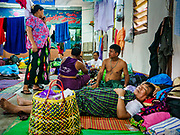 28 NOVEMBER 2017 - YANGON, MYANMAR: A man whose family said was going to the papal mass Wednesday sleeps in a parish hall at St. Francis of Assisi Church in Yangon. About 1,500 people are camping at the church before the papal mass at Kyaikkasan Sports Ground, about three kilometers from the church.     PHOTO BY JACK KURTZ
