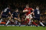 Bradley Davies of Wales runs at Scotland's Ryan Wilson (20). Wales v Scotland, NatWest 6 nations 2018 championship match at the Principality Stadium in Cardiff , South Wales on Saturday 3rd February 2018.<br /> pic by Andrew Orchard, Andrew Orchard sports photography