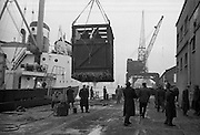 """16/01/1960<br /> 01/16/1960<br /> 16 January 1960<br /> Horses for slaughter being loaded for export to the Netherlands from Dublin. Horses being loaded by crane onto the Dutch ship """"Theano""""."""