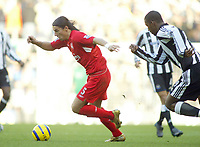 19/12/2004 - FA Barclays Premiership - Liverpool v Newcastle United - Anfield, Liverpool<br />Liverpool's Milan Baros gets away from Newcastle United's Titus Bramble.<br />Photo:Jed Leicester/Back Page Images