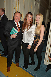 Left to right, ANDREW NEIL, his wife SUSAN and her sister ANNA NILSSON at a party to celebrate the publication of The Romanovs 1613-1918 by Simon Sebag-Montefiore held at The Mandarin Oriental, 66 Knightsbridge, London on 2nd February 2016.