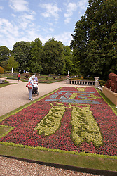 © Licensed to London News Pictures.  30/05/2012. Waddesdon, UK. Visitors to Waddesdon Manor, near Aylesbury and owned by the National Trust, admire a just finished carpet of bedding plants, including the official emblem, in honour of the Queens Diamond Jubilee. *** Taken with permission of Waddesdon Manor press office ***. Photo credit :  Cliff Hide/LNP