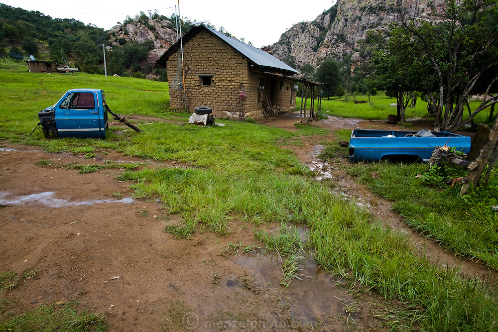 The body and cab of a pickup truck lie outside Jose Angel Galaviz Carrillo's house near the village in Maycoba, in the state of Sonora, Mexico. (Jose Angel Galaviz Carrillo is featured in the book What I Eat: Around the World in 80 Diets.)