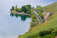 Train tanker cars sit along the tracks next to Kalamalka Lake just outside of Vernon, British Columbia, Canada.