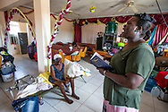 Dieula Ponne holds a Hymnal as she sings during Sunday service at First Beraca Baptist Church in Marsh Harbour on Abaco Island on Sunday, September 8, 2019.