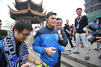 Argentine football star Javier Zanetti, center, is followed by Chinese fans during his visit to the Yellow Crane Tower ahead of the 2014 China-Italy The Football Legends Challenge Match in Wuhan city, central China's Hubei province, 17 October 2014.<br /> <br /> Javier Zanetti led Inter Milan legends to visit the Yellow Crane Tower in Wuhan city, central Chinas Hubei province, on Friday (17 October 2014). The 2014 China-Italy The Football Legends Challenge Match will kick off on Sunday.