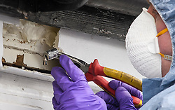 © Licensed to London News Pictures. 04/04/2018. London, UK. Forensics use a magnet to recover a bullet from the window frame of a property on Chalgrove Road in Tottenham, north London where 17 year old Tanesha Melbourne was shot dead. A recent spree of killings in the capital has taken the murder toll for the year so far to 48. Photo credit: Ben Cawthra/LNP