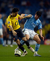 Photo: Jed Wee.<br /> Manchester City v Arsenal. The Barclays Premiership. 04/05/2006.<br /> <br /> Arsenal's Cesc Fabregas (L) scraps with Manchester City's Joey Barton.