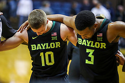 Jan 21, 2019; Morgantown, WV, USA; Baylor Bears guard Makai Mason (10) and Baylor Bears guard King McClure (3) pray after the game against the West Virginia Mountaineers at WVU Coliseum. Mandatory Credit: Ben Queen-USA TODAY Sports