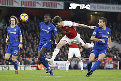 BRITAIN-LONDON-FOOTBALL-PREMIER LEAGUE-ARSENAL VS CHELSEA.(190120) -- LONDON, Jan. 20, 2019  Arsenal's Laurent Koscielny heads the ball towards the goal watched by Chelsea's David Luiz (L) , Antonio Rudiger (C) and Cesar Azpilicueta (R) during the English Premier League match between Arsenal and Chelsea at the Emirates Stadium in London, Britain on Jan. 19, 2019. Arsenal won 2-0.  FOR EDITORIAL USE ONLY. NOT FOR SALE FOR MARKETING OR ADVERTISING CAMPAIGNS. NO USE WITH UNAUTHORIZED AUDIO, VIDEO, DATA, FIXTURE LISTS, CLUB/LEAGUE LOGOS OR ''LIVE'' SERVICES. ONLINE IN-MATCH USE LIMITED TO 45 IMAGES, NO VIDEO EMULATION. NO USE IN BETTING, GAMES OR SINGLE CLUB/LEAGUE/PLAYER PUBLICATIONS. (Credit Image: © Matthew Impey/Xinhua via ZUMA Wire)